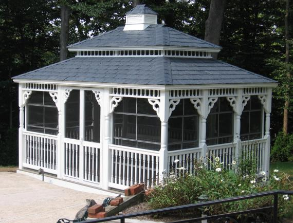 White vinyl rectangle gazebo with ornate details and cupola