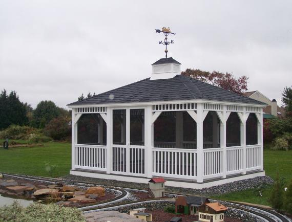 White vinyl rectangle gazebo with weather vane