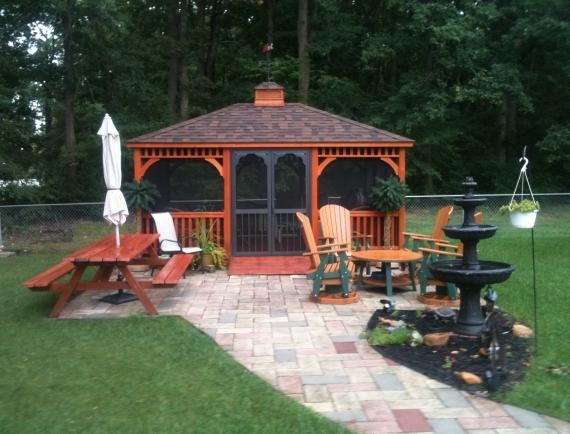 Brown wood rectangle gazebo with weather vane