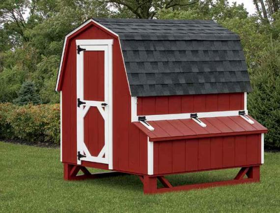 Barn style chicken coop in red with white trim